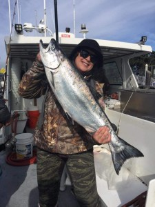 This woman successfully battled this big Chinook salmon while trolling outside the Golden Gate with the New Easy Rider.