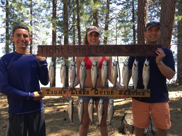 Russ Cipriani, Lucy Cipriani and Griffin Cipriani of Novato proudly display their limits of kokanee taken on a trolling adventure with Captain James Netzel.