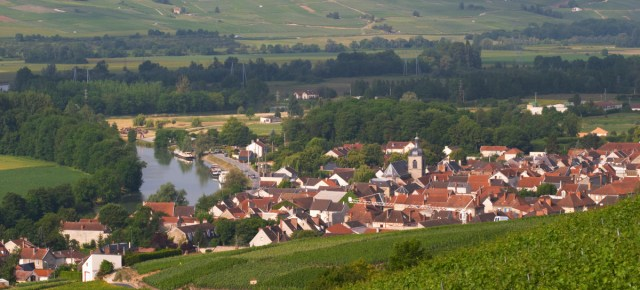 A view of the Vallee de la Marne river and vineyards and the village Cumieres, the village of Hautvillers in Vallee de la Marne, Champagne, Marne, Ardennes, France