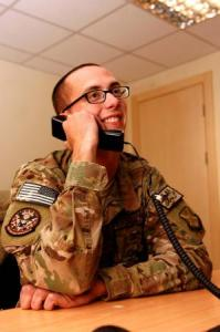 Air Force Staff Sgt. Dustin Hawkins of the 451st Expeditionary Civil Engineer Squadron at Kandahar Airfield, Afghanistan took a call from President Obama on Thanksgiving Day.