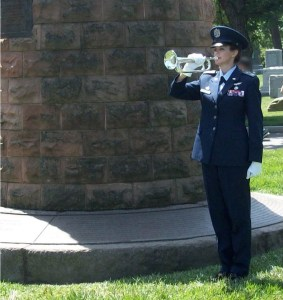 Civil Air Patrol Maj. Jaimie L Henson plays taps at military funerals as a volunteer with Bugles Across America. Courtesy of Jaimie L Henson.