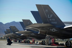 Staff Sgt. Michael Ensminger, 61st Aircraft Maintenance Unit Staff F-35 dedicated crew chief inspects one of Luke's 10 F-35s sent to Nellis Air Force Base, Nevada for the training deployment April 15, 2015. (Staff Sgt. Darlene Seltmann/Air Force)