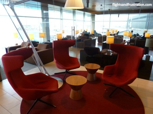 Funky high back red swivel chairs at the KLM Crown Lounge
