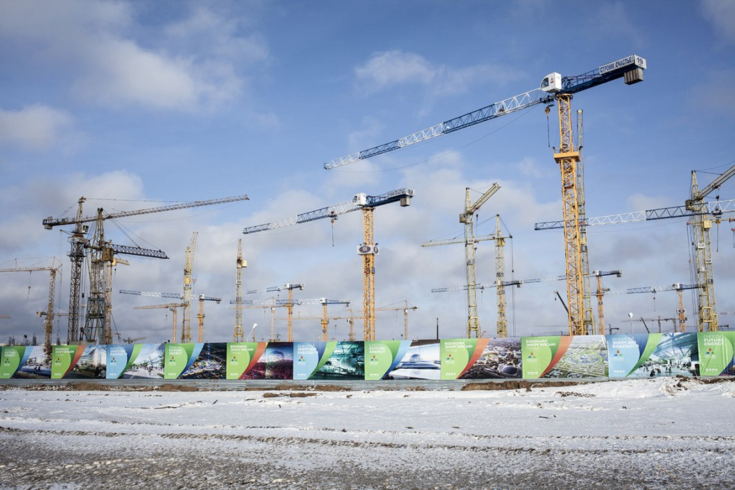 A crowd of cranes are seen in the construction site where the Expo 2017 pavillions will be built. Astana is going to host the international exposition in 2017 on the theme of Future Energy. Astana is the capitol of Kazakhstan, the largest land-located country in the world. Kazakhstan (previously known as Eastern Siberia) is rich of natural resources like gas and oil and has been the last country to leave USSR in 1991. Since then has known a dramatic development attracting more and more foreigner investment. Most of its territory is composed by steppe, freezing in winter (temeperature can reach minus 50 degrees celcius) and burning in summer. However many people are moving to the capitol, Astana, attracted by the chance of a better future. In 2017 Astana will host Expo 2017 on the theme of Future Energy.
