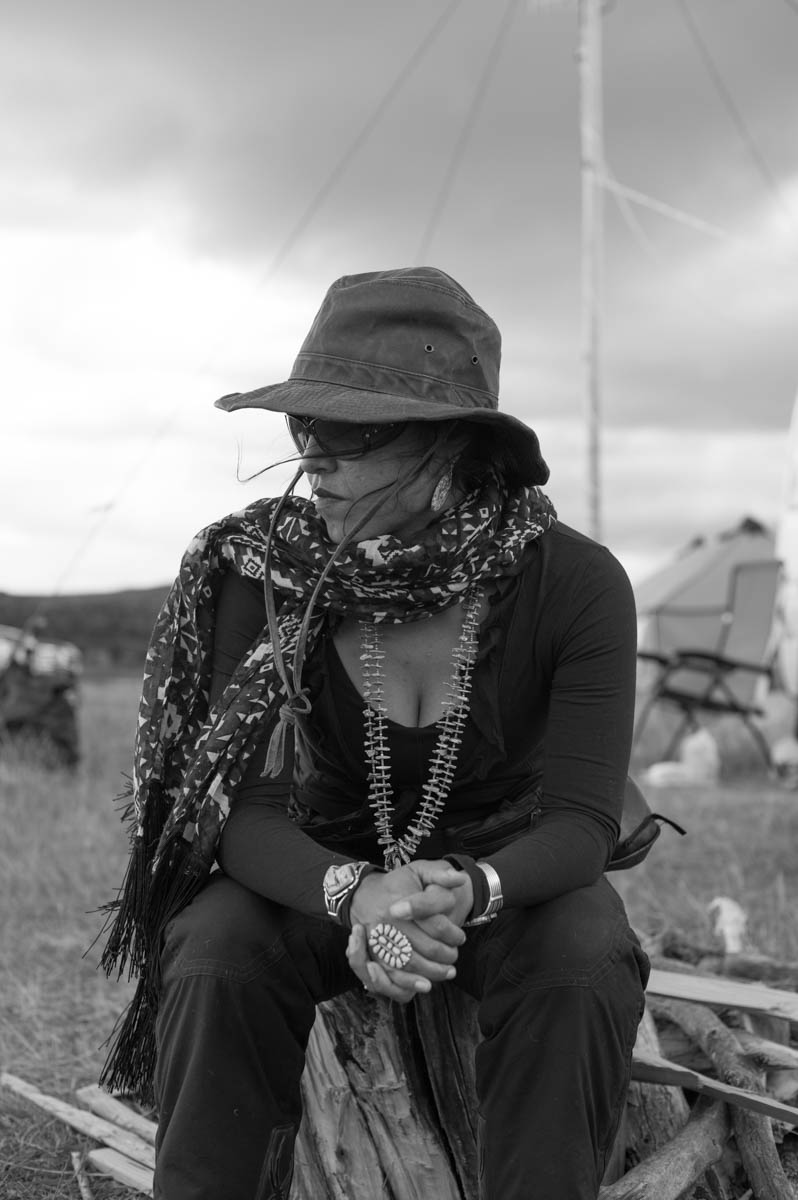 Michelle, a Navajo Human Rights Activist sitting in front of the media van on top of the Facebook Hill overlooking the camp