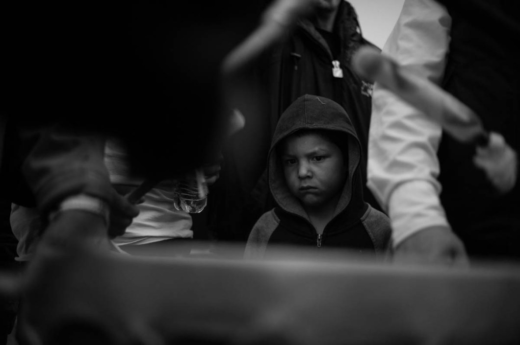 After the Department of Justice put a temporary halt on the pipeline project, people circled around drums, singing the song of Sitting Bull. This little boy was in deep thoughts in the crowd, inches away from the loud drum beats