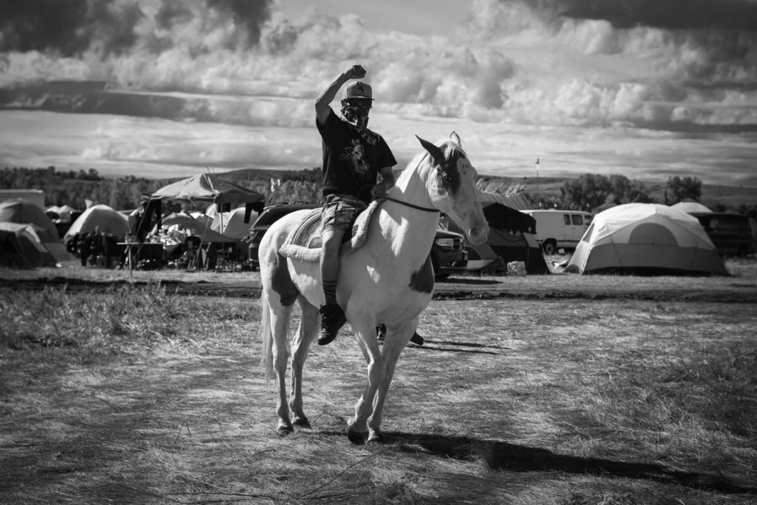 MJ, one of the masked warriors who did not want to disclose his full name patrolling the camp on his horse named Champagne. Drugs, violence and alcohol was strictly banned at the camp. Camp security was also aware of possibility of provocateurs urging young warriors to violence towards law enforcement. Everyone was asked to be vigilant, peaceful and join the prayer ceremonies
