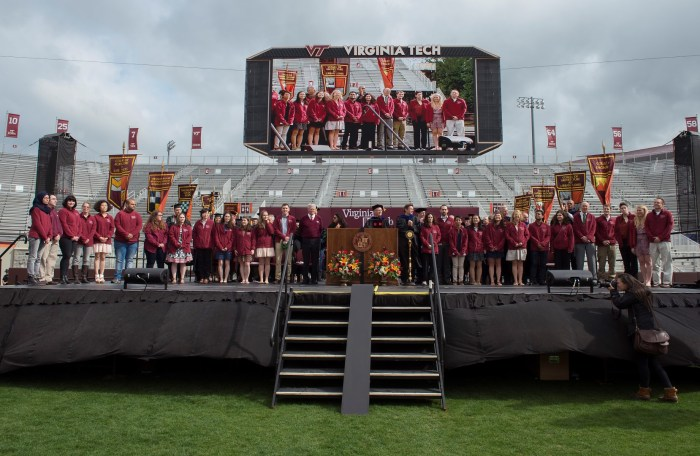 Professor Marc Edwards and Dr. Mona Hanna-Attisha introducing the Flint, MI research team at the Virginia Tech 2016 commencement ceremony.