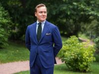 Wearing a Blue Suit with a Green Tie