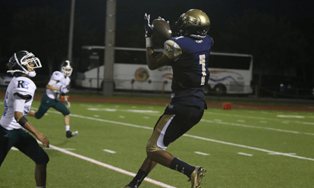 North Broward Prep receiver C.J. Riley makes a catch against Ransom Everglades. (Photo: Alex Vigna)