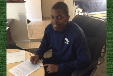 North Broward Prep receiver C.J. Riley officially signs with N.C. State
