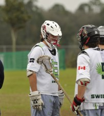 Lake Brantley's Tim Gehlbach and LHP's Max Parker talk it over on the sidelines for Sweetlax
