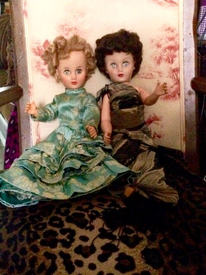 Dolls in chair