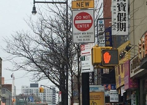 Photo via Twitter/NYPD109Pct Photo via Twitter/NYPD109Pct . New signage posted at 37th Avenue and Main Stree