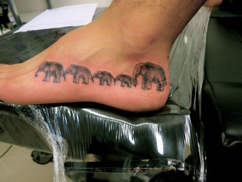 85 beautiful elephant tattoos and their meanings for Elephant tattoo meaning family