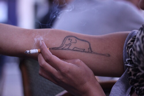 85 beautiful elephant tattoos and their meanings for Small bicep tattoos