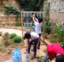 The kids learned how to use a vertical planting kit when agricultural land is not available