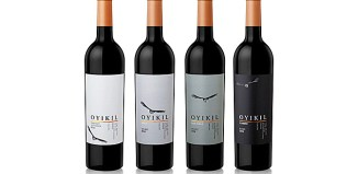 four bottles showing wine labeling