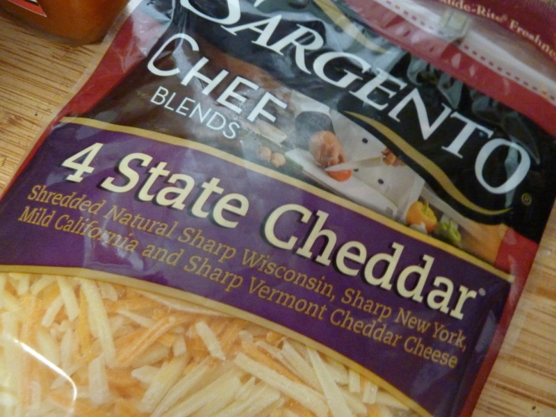 Chedder might not be traditional but it goes well with the wing sauce and blue cheese.  I like the sargento 4 state chedder mix.
