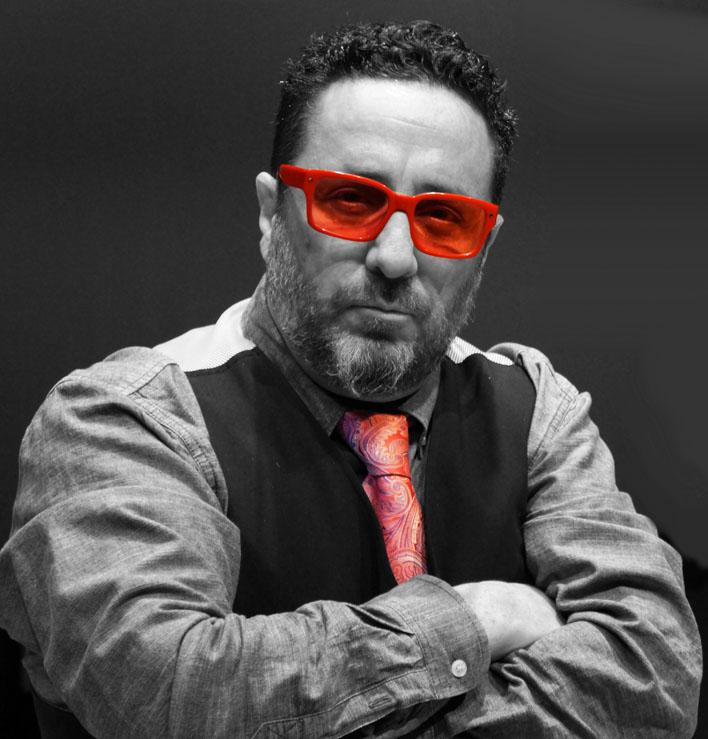 galinsky headshot bw red glasses small