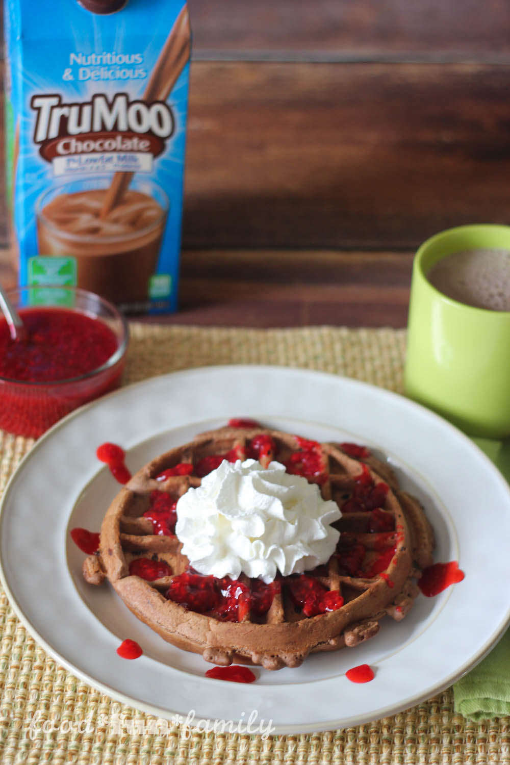 These Triple Chocolate Waffles with Raspberry Sauce are light and fluffy, with just the right amount of chocolate and sugar. Cocoa powder, TruMoo chocolate milk, and semi-sweet chocolate chips combine to make the perfect chocolate waffle for a special breakfast treat! They're delicious enough on their own, but with the addition of a homemade raspberry sauce, this is a Valentine's Day breakfast to die for!