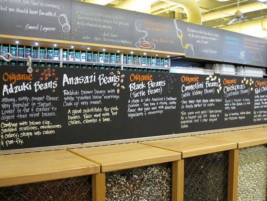 Informative displays topping bulk legume bins at Whole Foods Market Lamar, Austin, Texas