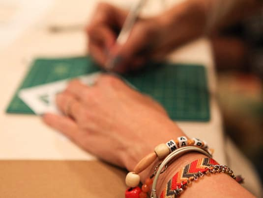 Working on my project at the Cut Paper Crafts design camp with Patricia Zapata (c) b.a.d photography