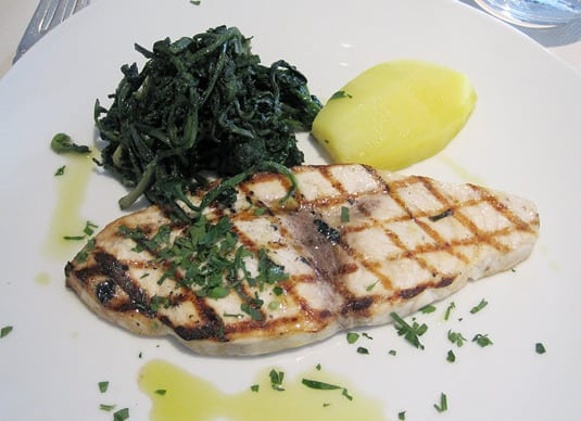 Pesce spada  - grilled swordfish with wilted greens and super-flavorful olive oil