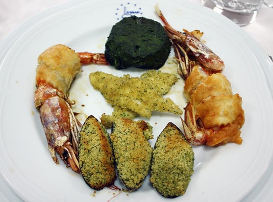 Giant prawns, white fish fillets, mussels and a spinach and ricotta flan
