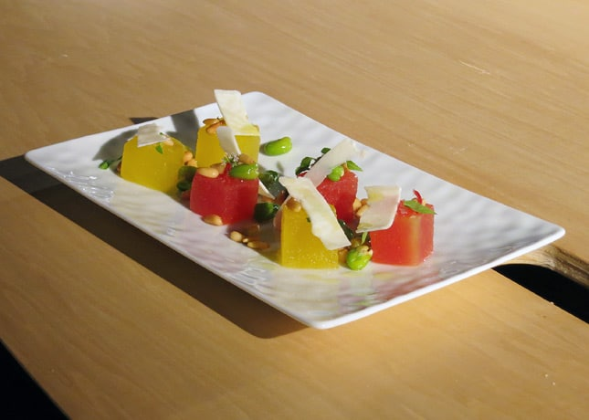 Chef Grgory Marchand's two melon salad with citrus oil, edamame peas, toasted pine nuts, chili, wild mint and ricotta salata, at the Omnivore Food Festival, Montreal / FoodNouveau.com