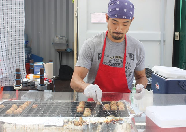 Takoyaki in the making at the Montreal Takoyaki kiosk. / FoodNouveau.com