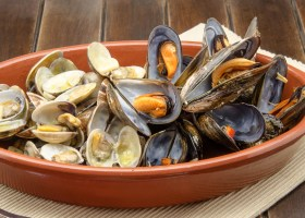 Clams and mussels with garlic served in a casserole