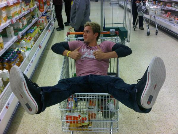 Bolton Wanderers' Stuart Holden in a shopping trolley, of course.