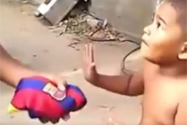 A boy refuses a Barcelona shirt before taking a Real Madrid shirt instead