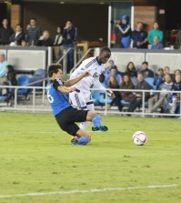 Shea Salinas pokes the ball out from under Manneh.