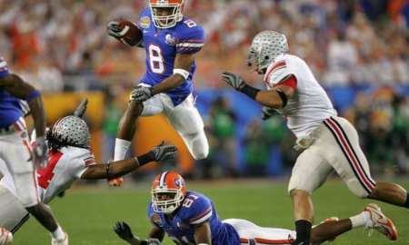 GLENDALE, AZ - JANUARY 08:  Wide receiver Percy Harvin #8 of the Florida Gators runs with the ball after a reception against the Ohio State Buckeyes during the 2007 Tostitos BCS National Championship Game at the University of Phoenix Stadium on January 8, 2007 in Glendale, Arizona.  (Photo by Doug Pensinger/Getty Images) *** Local Caption *** Percy Harvin;Dallas Baker