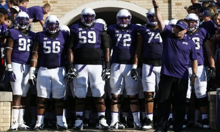 TCU head coach Gary Patterson salutes the crowd as he prepares to lead his team onto the field against Samford before an NCAA college football game in Fort Worth, Texas, Saturday, Aug. 30, 2014. (AP Photo/Jim Cowsert)