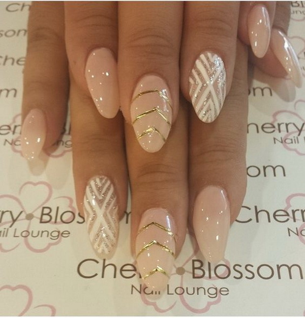 Pink and White Almond Nails with Gold V-shaped Strips