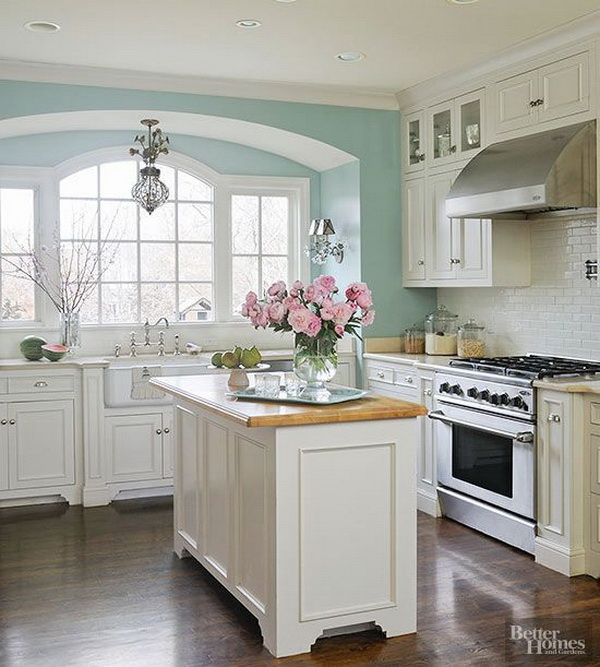 white kitchen with a bit of airy bright blue paint more via http