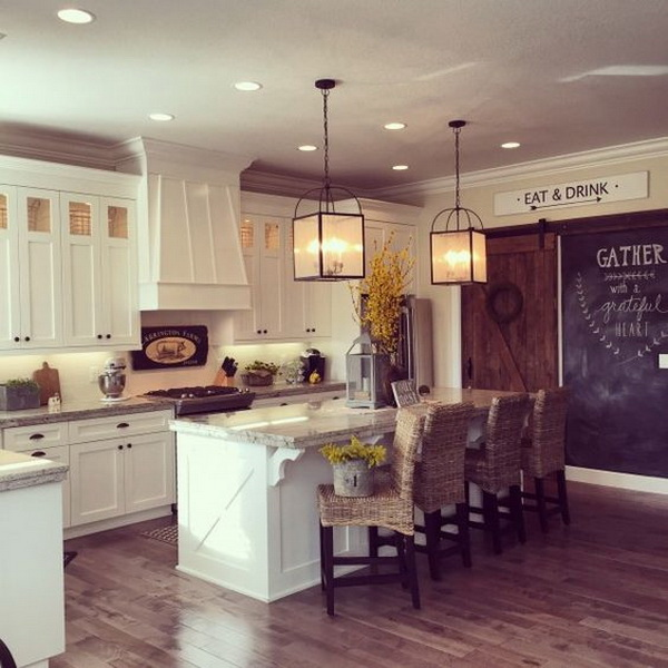 white kitchen with lots of farmhouse flair including the rolling barn wood door chalkboard wall