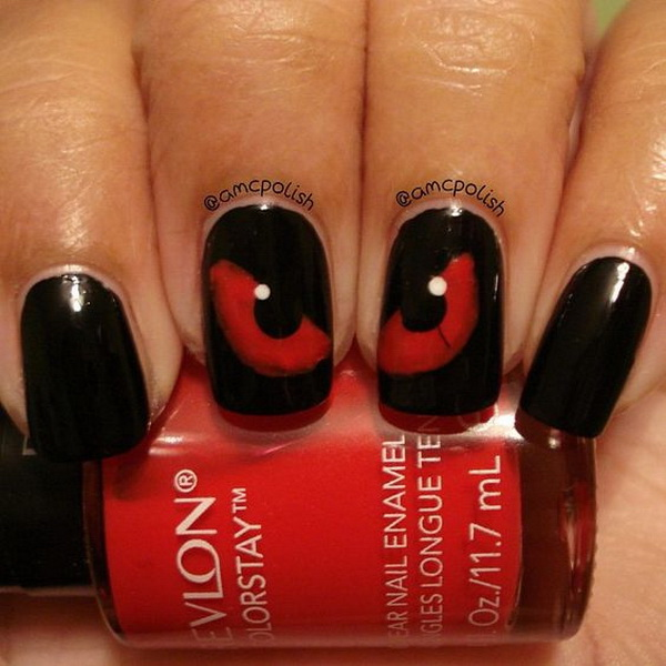 As you might have noticed, not all Halloween nails have to be scary. They can be quite elegant if you think about. This manicure is a perfect example. The red and black ombre is just amazing, and all you need is a spider web for a more Halloween-themed manicure. 4. Sugar Skull Designs.