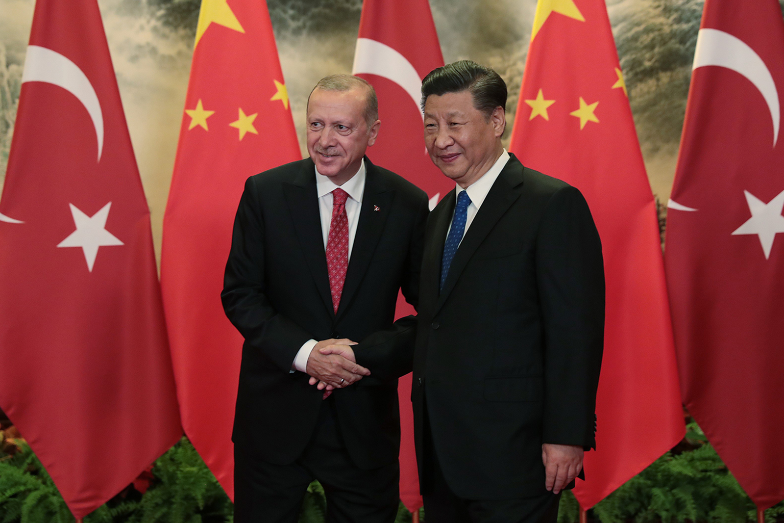 Turkish President Recep Tayyip Erdogan and Chinese President Xi Jinping shake hands after an official welcoming ceremony in Beijing on July 2.