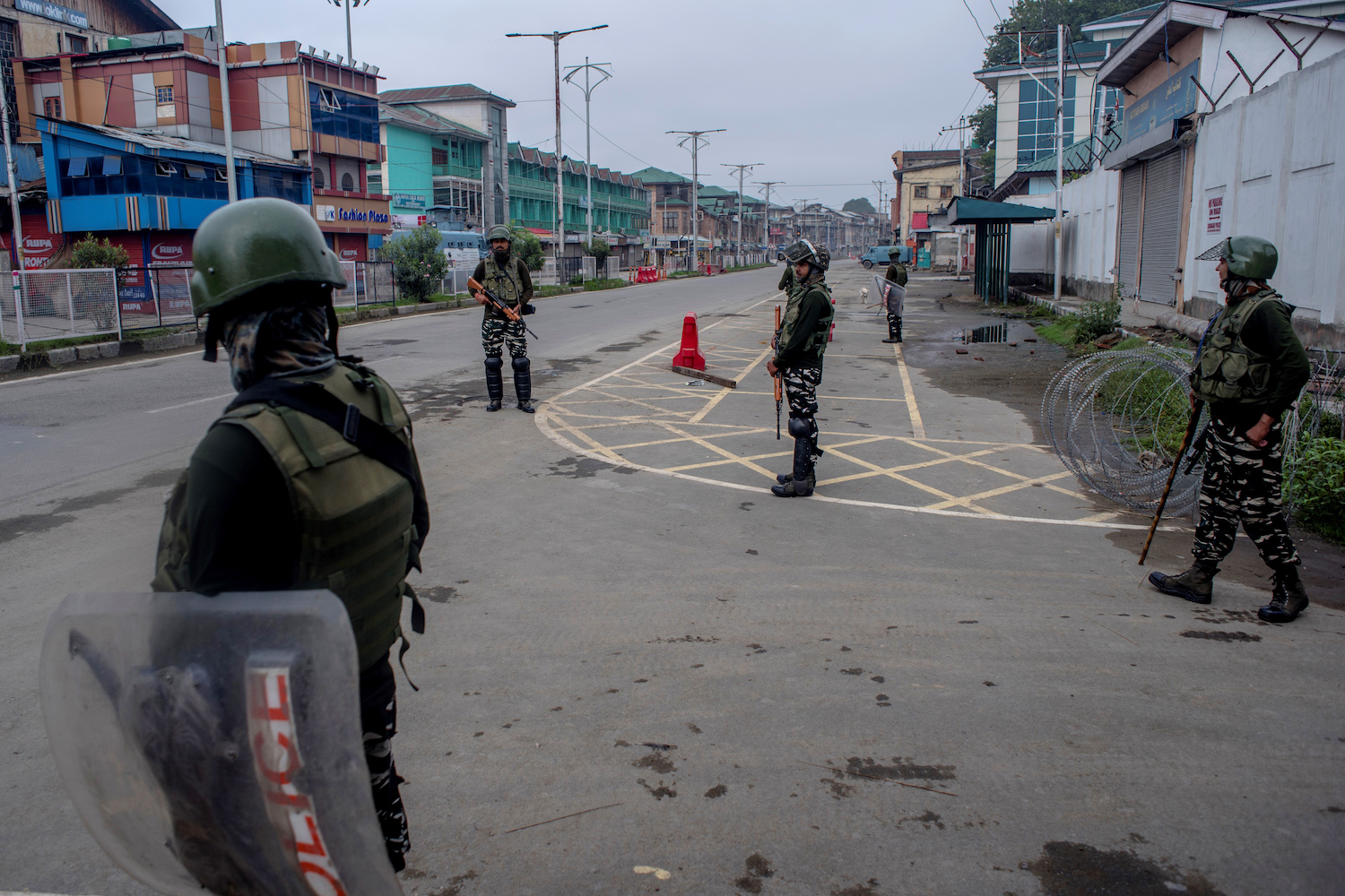 Indian government forces stand guard in the deserted city center of Srinagar on Aug. 15.