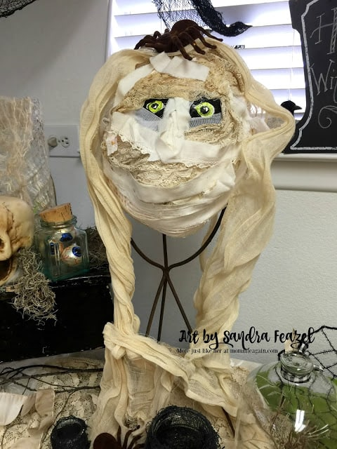 Handmade mummy from old tie-dyed ribbons and lace