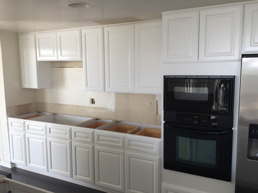 Rta Kitchen Cabinets Los Angeles Kitchen White Raised Panel Cabinets And Black Quartz