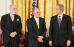 George W. Bush (right) stands with Presidential Medal of Freedom recipients, Vinton G. Cerf (left) and Robert E. Kahn (middle), Wednesday, Nov. 9, 2005, during ceremonies at the White House. Cerf and Kahn were honored for their work in helping to create the modern Internet. Photo courtesy Wikimedia Commons.