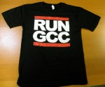 'It's Tricky, to compile software that's right on time . . . ' The 'Run GCC' shirt and stickers from the Free Software Foundation were a hit at LinuxFest Northwest (Free Software Foundation)