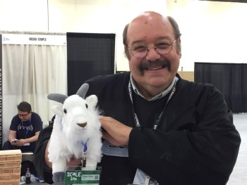 Taking a minute from talking with Dru Lavigne and Deb Goodkin at the FreeBSD booth to pose with a booth denizen, the BSD goat. (Photo by Deb Goodkin)