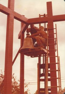 Congregation Members Moving the Original Church Bell to the New Bell Tower