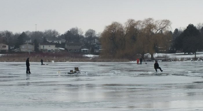 Ice fishermen - Frenchman's Bay - Ontario - Canada